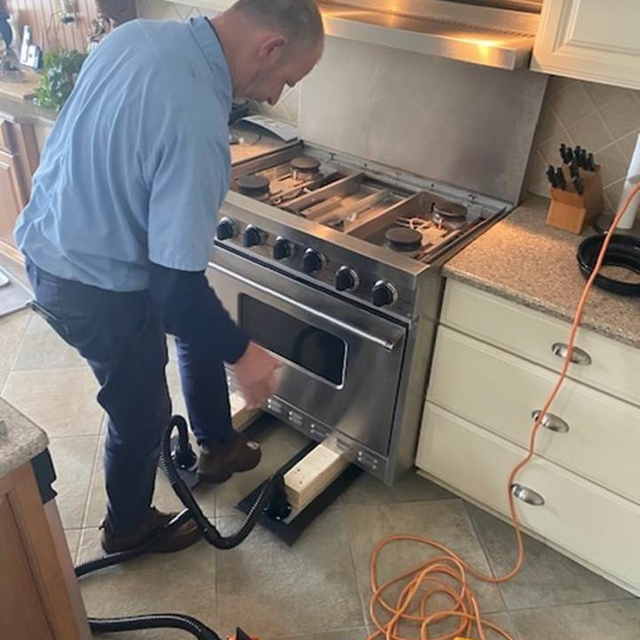 person working on stove